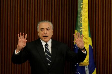 Brazil's President Michel Temer gestures during a meeting with the Pension Reform Commission at the Planalto Palace in Brasilia