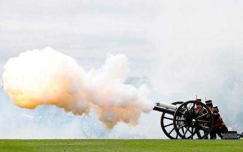 Members of the Kings Troop Royal Horse Artillery fire a First World War era 13-pounder field gun during a 41 gun Royal salute - Credit: ADRIAN DENNIS /AFP