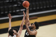 Colorado's Evan Battey, right, shoots over Oregon State's Roman Silva during the second half of an NCAA college basketball game in Corvallis, Ore., Saturday, Feb. 20, 2021. (AP Photo/Amanda Loman)