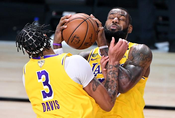 Lakers forwards LeBron James and Anthony Davis collide as they try to grab a rebound during Game 1.