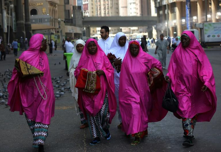 Pilgrims walk outside the Grand Mosque in Saudi Arabia's holy city of Mecca on August 16, 2018