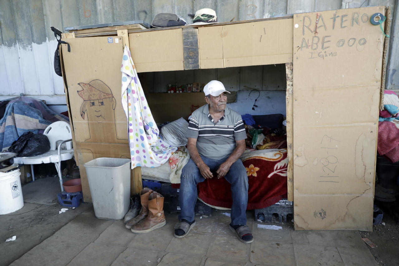 This Tuesday, Sept. 18, 2018 photo, shows Higinio Castillo Ruiz, a longtime farmworker, living in a homeless camp on the grounds of what was once a melon packing shed in Huron, Calif. The region is unrivaled for farm production, but the rich earth has not given back equally to those who toil out of view of millions of tourists and Californians who pass through the valley each year. (AP Photo/Marcio Jose Sanchez)
