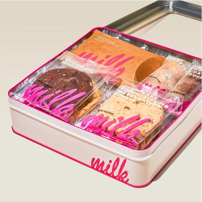 """Whether they know all about Milk Bar or have yet to discover the magical desserts, this variety pack will be a welcome treat. It includes a sample of the greats from the buzzy New York bakery, like its famous birthday truffles, a variety of cookies, and a single slice of ooey-gooey Milk Bar Pie—all packed in a reusable windowed tin they can store <a href=""""https://www.glamour.com/lipstick/makeup?mbid=synd_yahoo_rss"""" rel=""""nofollow noopener"""" target=""""_blank"""" data-ylk=""""slk:makeup"""" class=""""link rapid-noclick-resp"""">makeup</a> in later. $52, Milk Bar. <a href=""""https://milkbarstore.com/products/milk-bar-bakery-gift-box"""" rel=""""nofollow noopener"""" target=""""_blank"""" data-ylk=""""slk:Get it now!"""" class=""""link rapid-noclick-resp"""">Get it now!</a>"""