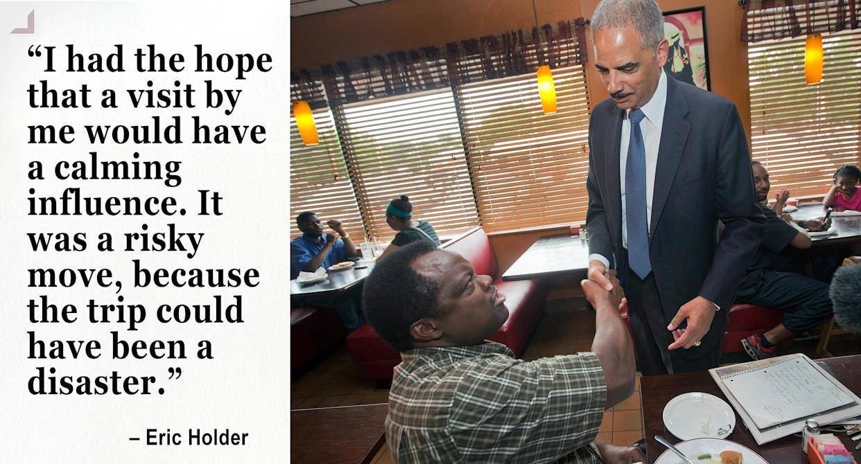 Then Attorney General Eric Holder stops to shake hands with a patron at Drake's Place restaurant in Ferguson. (Photo: Pablo Martinez Monsivais-Pool/Getty Images)