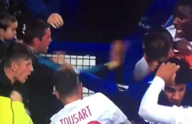 everton fan with baby joins fight during lyon match