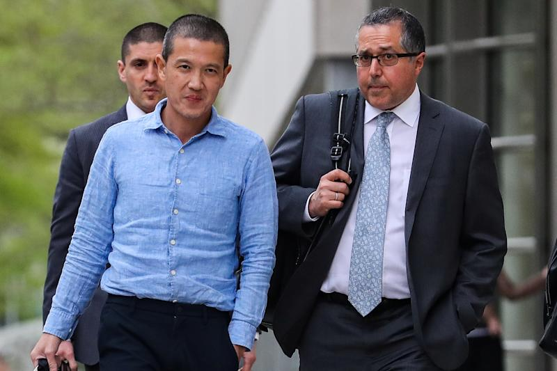 Ex-Goldman Sachs banker Roger Ng and his lawyer Marc Agnifilo leave the federal court in New York, U.S., May 6, 2019. REUTERS/Jeenah Moon