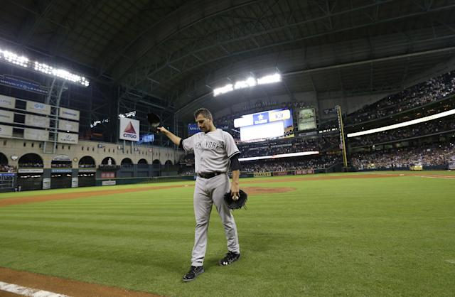 New York Yankees starting pitcher Andy Pettitte tips his hat to the crowd after pitching a complete baseball game against the Houston Astros Saturday, Sept. 28, 2013, in Houston. The Yankees beat the Astros 2-1. Pettitte is retiring at the end of the season.(AP Photo/David J. Phillip)