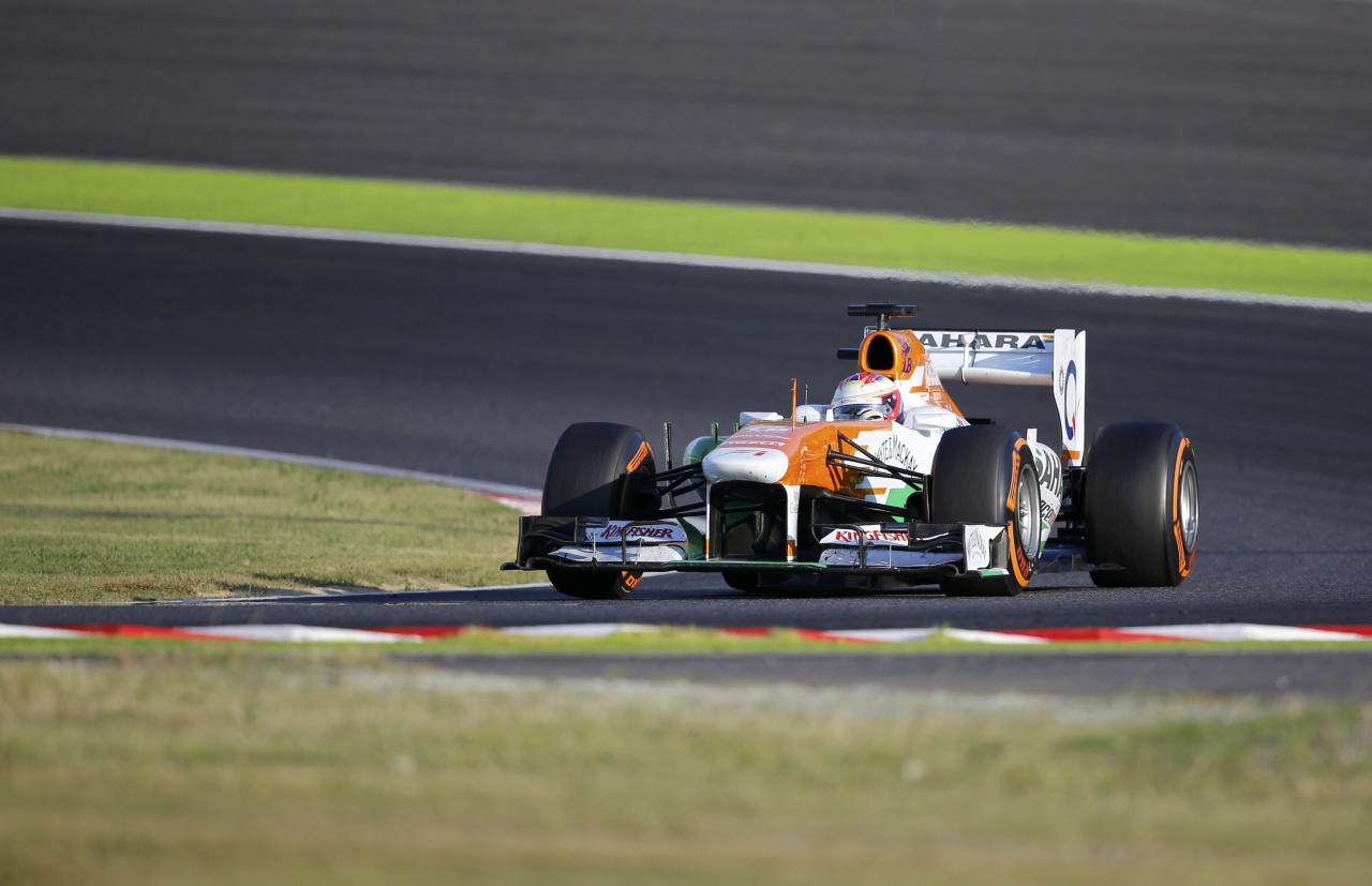Force India Formula One driver Paul di Resta of Britain races during the Japanese F1 Grand Prix at the Suzuka circuit October 13, 2013. REUTERS/Issei Kato (JAPAN - Tags: SPORT MOTORSPORT F1)