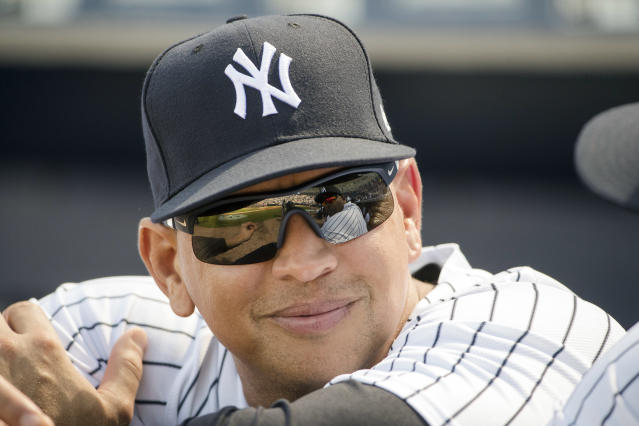 FILE - In this Feb. 24, 2017, file photo, New York Yankees special advisor Alex Rodriguez speaks with CC Sabathia, who reflected in his sunglasses, ahead of a spring training baseball game against the Philadelphia Phillies in Tampa, Fla. Rodriguez thinks the Yankees breathtaking offense could break records this season. He arrived at spring training Monday, March 19, 2018 and had high praise for a lineup led by Giancarlo Stanton, Aaron Judge, Gary Sanchez and Didi Gregorius. (AP Photo/Matt Rourke, File)