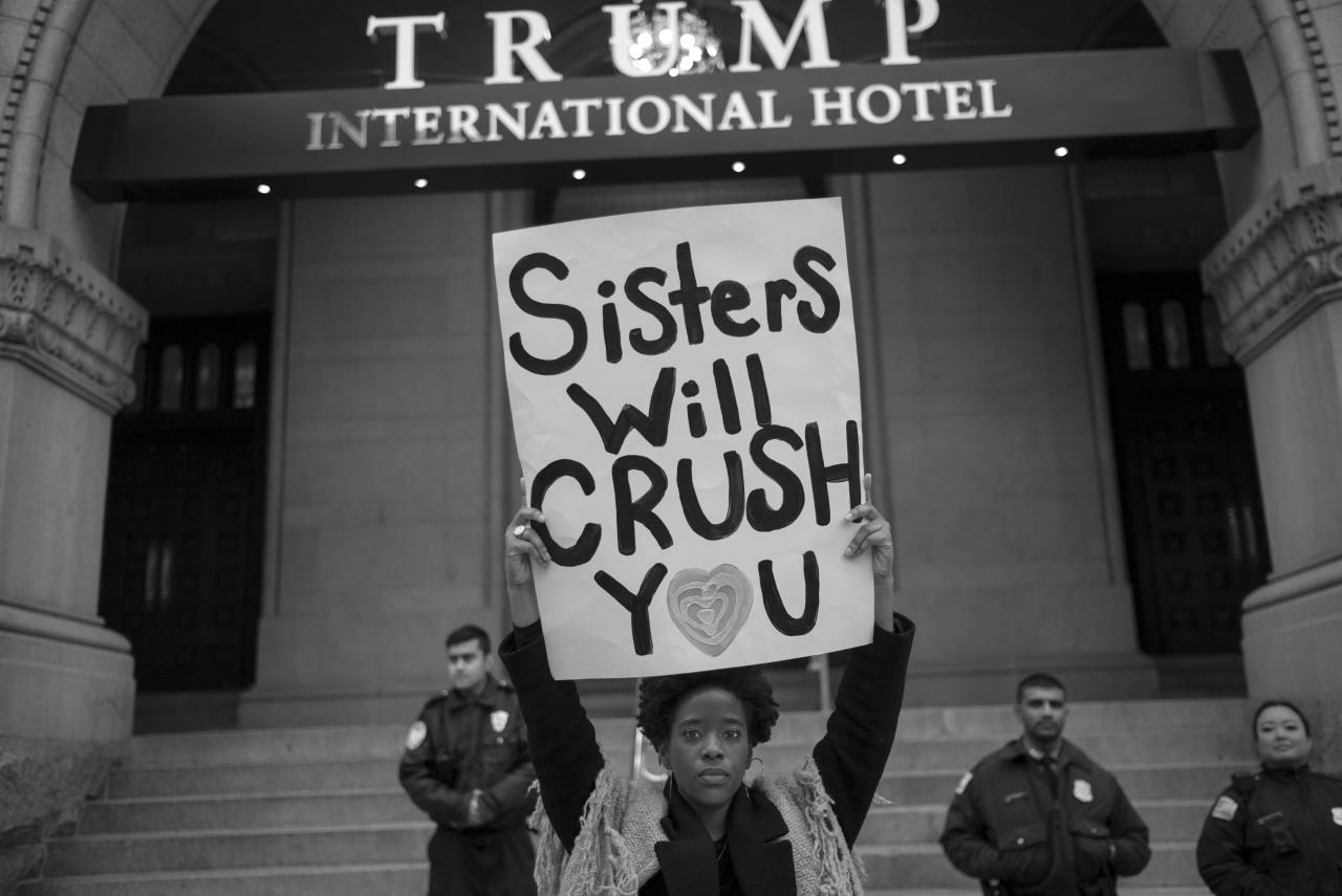 <p>A protestor holds up a sign in front of the Trump International Hotel during the Women's March on Washington the day after Inauguration Day in Washington on Jan. 21, 2017. (Photograph by Tomas van Houtryve/VII) </p>