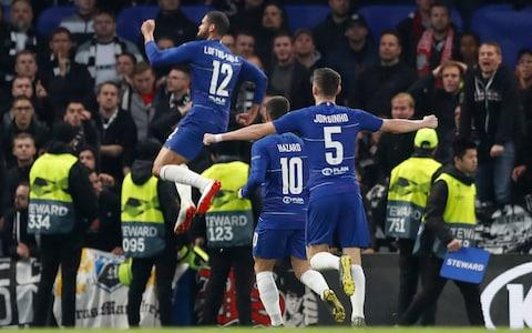 Chelsea's Ruben Loftus-Cheek jumps up as he celebrates scoring his side's first goal during the Europa League semifinal second leg soccer match between FC Chelsea and Eintracht Frankfurt - Credit: AP Photo/Alastair Grant