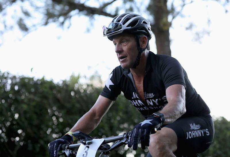 Lance Armstrong received an onslaught of Twitter comments after bragging about passing Vice President Mike Pence on the road in Nantucket. (Photo by Ezra Shaw/Getty Images)