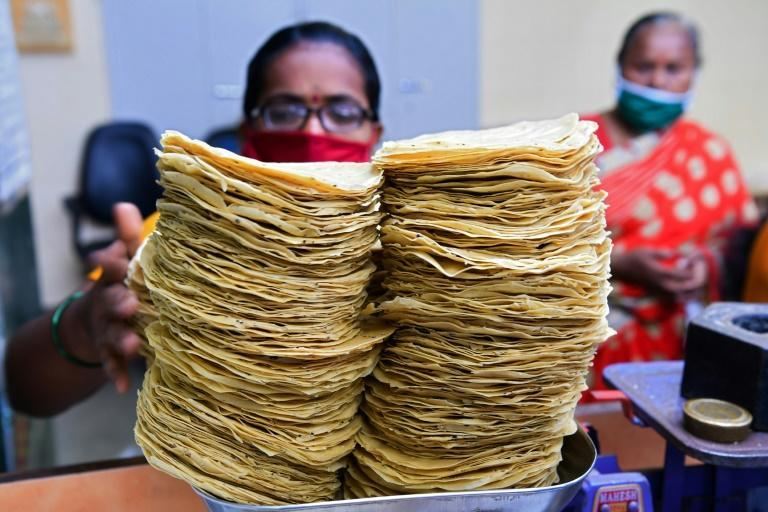 """Lijjat Papad now employs 45,000 women across India, offering them a job for life as """"co-owners"""" of the enterprise making wafer-thin snacks known as papads"""