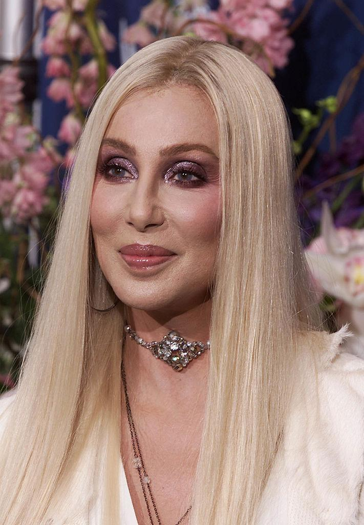 <p>Cher, seen here in 2000, ushered in the new millennium with newly platinum locks, serious cheekbones, and lips more luscious than ever before. <i>(Photo: Getty Images)</i></p>