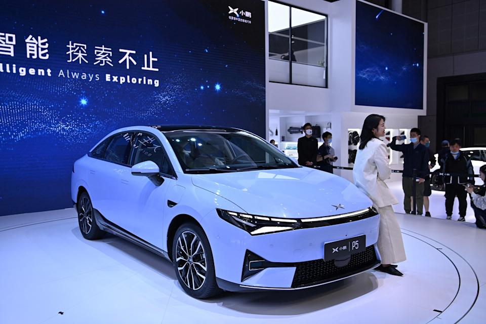 A Xpeng P5 car is seen during the 19th Shanghai International Automobile Industry Exhibition in Shanghai on April 19, 2021. (Photo by Hector RETAMAL / AFP) (Photo by HECTOR RETAMAL/AFP via Getty Images)