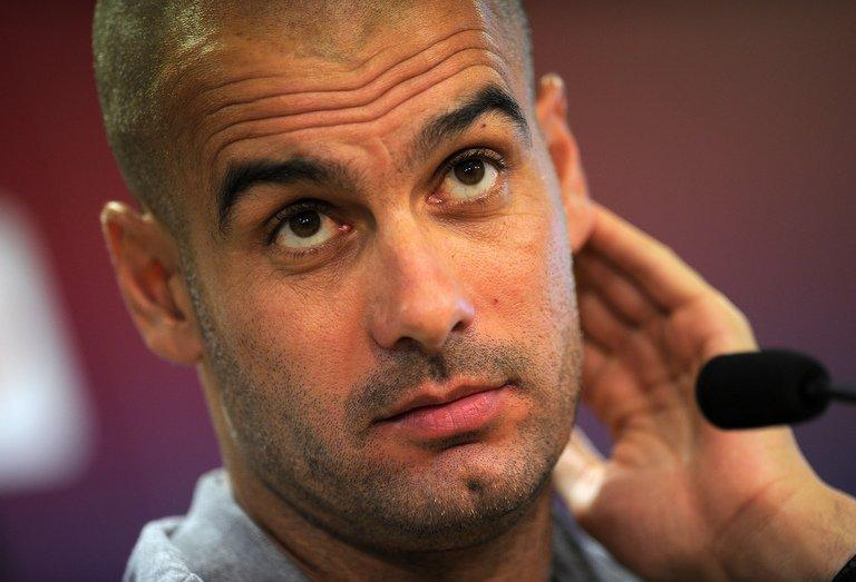 Then Barcelona coach Pep Guardiola gives a press conference at a sports centre near Barcelona on August 13, 2011