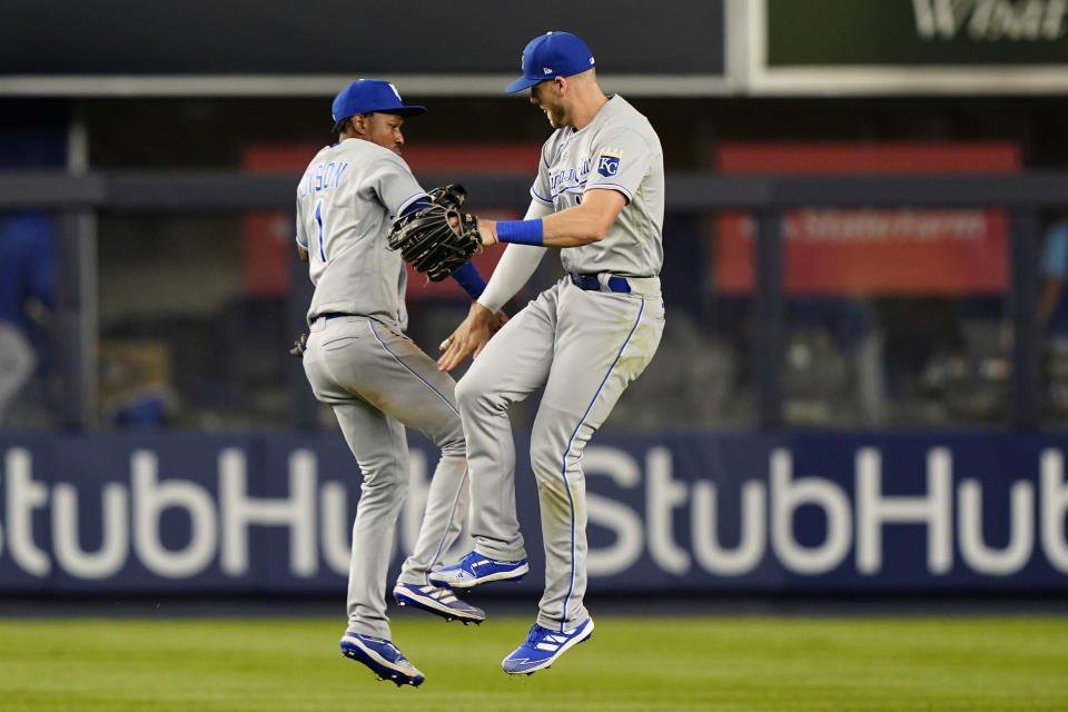 Kansas City Royals outfielders Jarrod Dyson (1) and Hunter Dozier (17) celebrate after the Royals 6-5 win over the New York Yankees in a baseball game, Tuesday, June 22, 2021, at Yankee Stadium in New York. The Royals defeated the Yankees 6-5. (AP Photo/Kathy Willens)