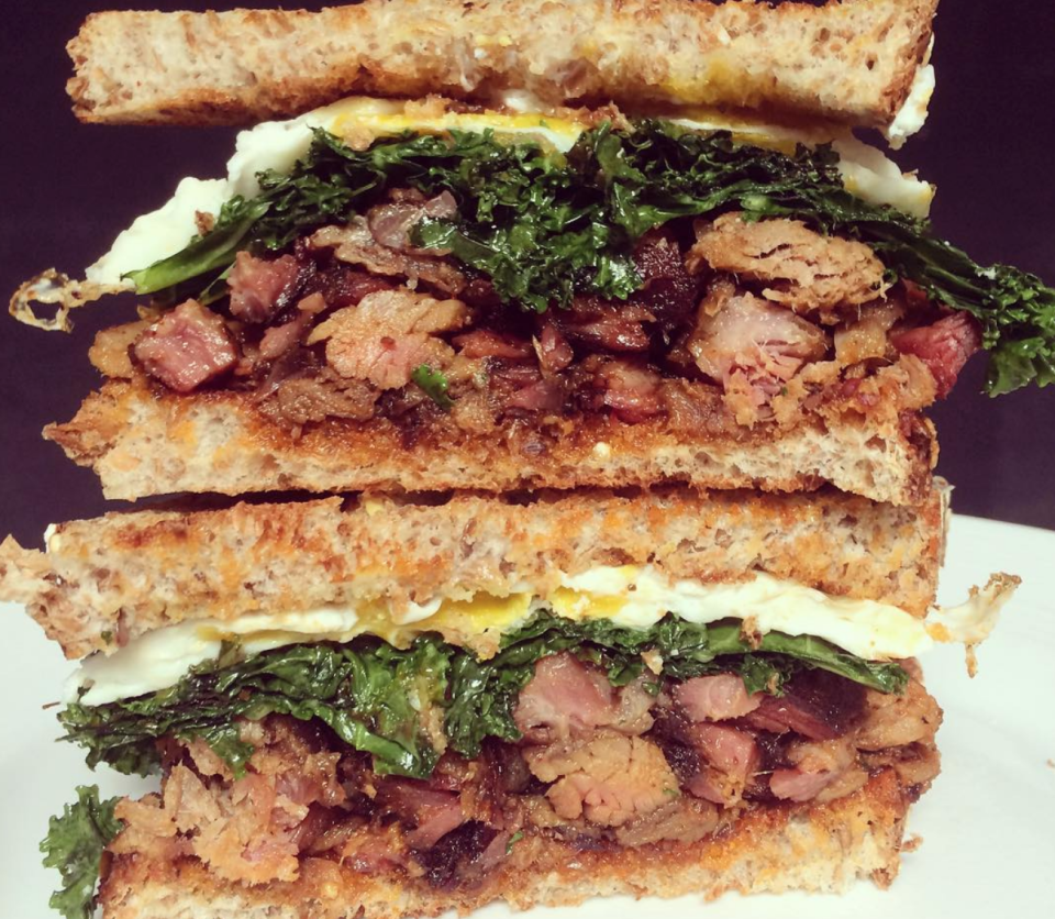 <p>Leftover BBQ pulled pork and ribs, stacked with a fried egg and sautéed kale on sprouted grain bread. In the words of Rae Sremmurd, this is how you start a party. Or at least a good dinner.</p>