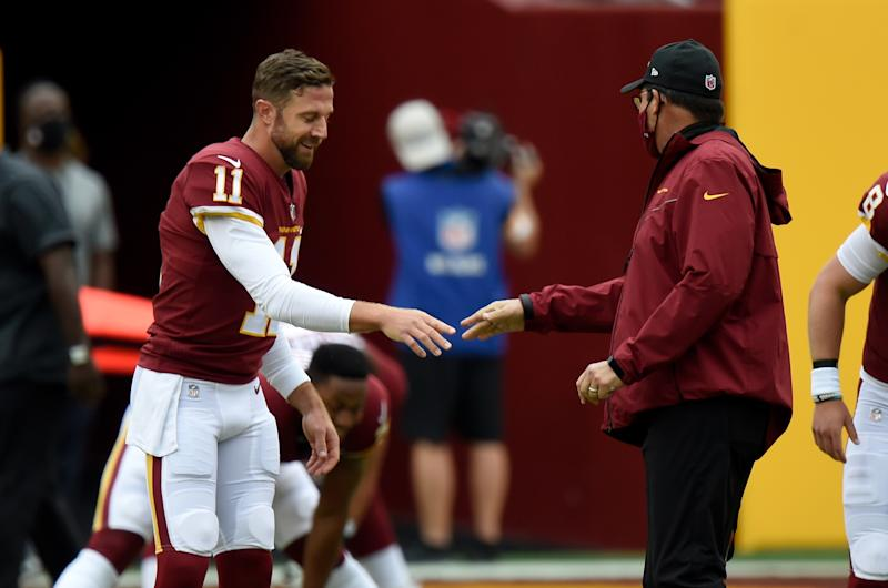 Alex Smith reaches out to shake Ron Rivera's hand.