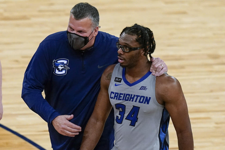 Creighton coach Greg McDermott walks with Denzel Mahoney (34) after the team's 59-56 win over Connecticut in an NCAA college basketball game in the semifinals in the Big East men's tournament Friday, March 12, 2021, in New York. (AP Photo/Frank Franklin II)