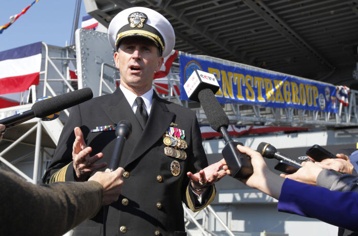 Chief of Naval Operations, Adm. Jonathan Greenert, gestures as he address the media in front of the USS Enterprise prior to an inactivation ceremony for the first nuclear powered aircraft carrier at Naval Station Norfolk Saturday, Dec. 1, 2012 in Norfolk, Va. The ship served in the fleet for 51 years. (AP Photo/Steve Helber)