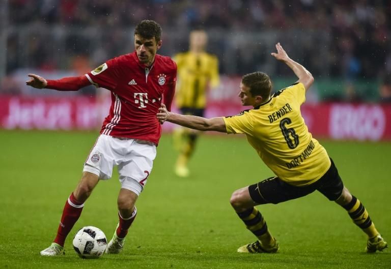 Bayern Munich's striker Thomas Mueller (L) and Dortmund's midfielder Sven Bender vie for the ball during the German Cup DFB Pokal semifinal football match April 26, 2017