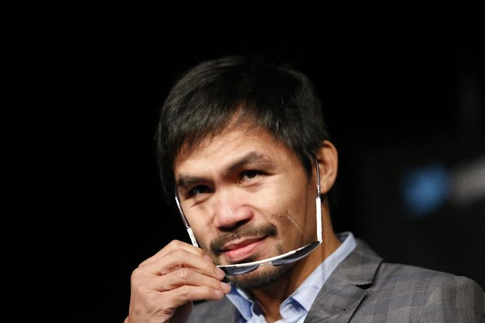 Manny Pacquiao, who converted from Catholicism to an evangelical Protestant faith late in his boxing career, created a global controversy this week when he described homosexuals as worse than animals (AFP Photo/Kena Betancur)
