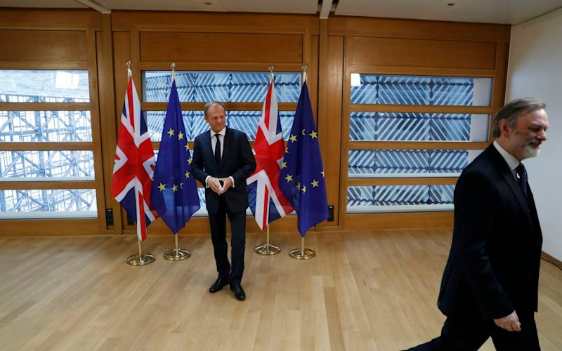 Sir Tim Barrow, Britain's EU ambassador, leaves EU Council President Donald Tusk after delivering Article 50 letter - REUTERS