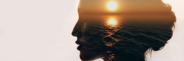 Woman silhouette with sunrise inside.
