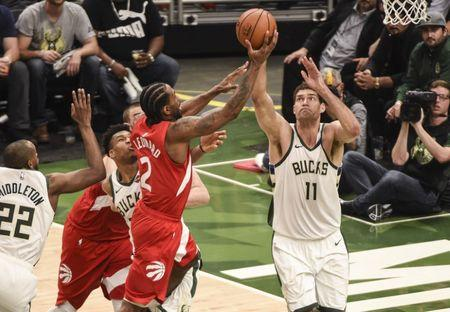 May 23, 2019; Milwaukee, WI, USA; Toronto Raptors forward Kawhi Leonard (2) shoots the ball as Milwaukee Bucks center Brook Lopez (11) defends in the fourth quarter in game five of the Eastern conference finals of the 2019 NBA Playoffs at Fiserv Forum. Mandatory Credit: Benny Sieu-USA TODAY Sports