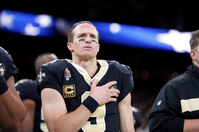 Brees will stand for anthem, but respects those who kneel