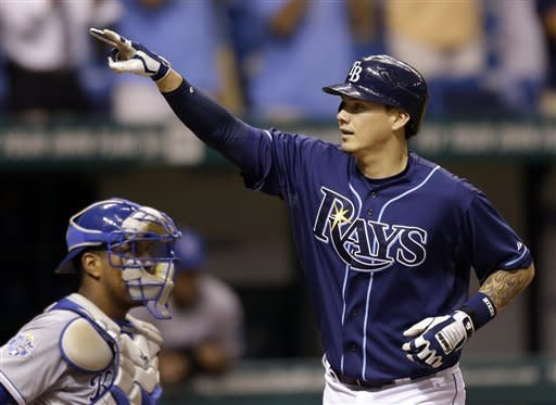 Tampa Bay Rays' Jose Lobaton reacts in front of Kansas City Royals catcher Salvador Perez after his eighth inning home run off Royals relief pitcher Aaron Crow during a baseball game Wednesday, Aug. 22, 2012 in St. Petersburg, Fla. (AP Photo/Chris O'Meara)