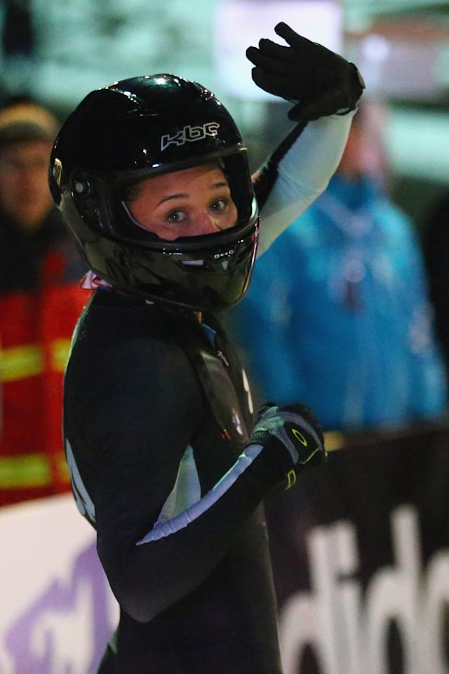 WINTERBERG, GERMANY - DECEMBER 08:  Olympic champion Lolo Jones of of United States waves to the crowd during the team competition of the FIBT Bob & Skeleton World Cup at Bobbahn Winterberg on December 8, 2012 in Winterberg, Germany.  (Photo by Christof Koepsel/Bongarts/Getty Images)