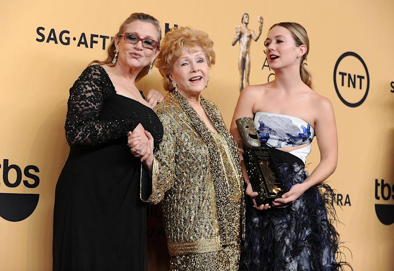 LOS ANGELES, CA - JANUARY 25: (L-R) Carrie Fisher, Debbie Reynolds and Billie Catherine Lourd pose in the press room at the 21st annual Screen Actors Guild Awards at The Shrine Auditorium on January 25, 2015 in Los Angeles, California. (Photo by Jason LaVeris/FilmMagic)