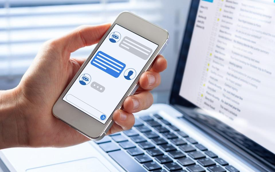 chatbot on a mobile phone - iStockPhoto