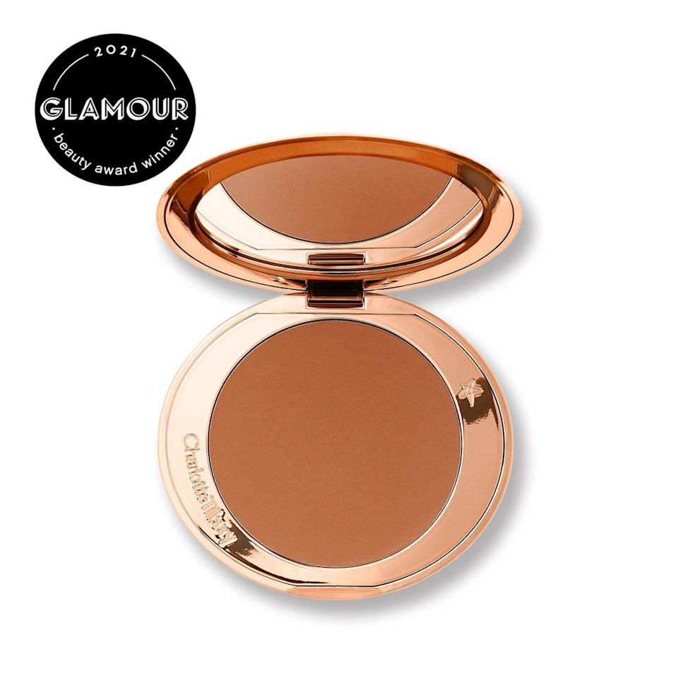 """This matte, silky powder received nothing but glowing praise from our <a href=""""https://www.glamour.com/story/beauty-awards?mbid=synd_yahoo_rss"""" rel=""""nofollow noopener"""" target=""""_blank"""" data-ylk=""""slk:Beauty Awards"""" class=""""link rapid-noclick-resp"""">Beauty Awards</a> judges—a mix of editors, influencers, and makeup artists. In other words: a tough crowd to please. """"After months of being stuck indoors, I'm officially as pale as I ever get,"""" says contributor Erin Parker. """"Thankfully, I've had this flawless matte bronzer at the ready—it's seriously undetectable and blends in so naturally. The true matte powder is honestly perfect for faking a tan (and accentuating your bone structure) quickly and effectively. This is the kind of bronzer you'll always get plenty of use out of, no matter where we're at in the makeup trend cycle."""" $55, Charlotte Tilbury. <a href=""""https://shop-links.co/1743417683568944878"""" rel=""""nofollow noopener"""" target=""""_blank"""" data-ylk=""""slk:Get it now!"""" class=""""link rapid-noclick-resp"""">Get it now!</a>"""