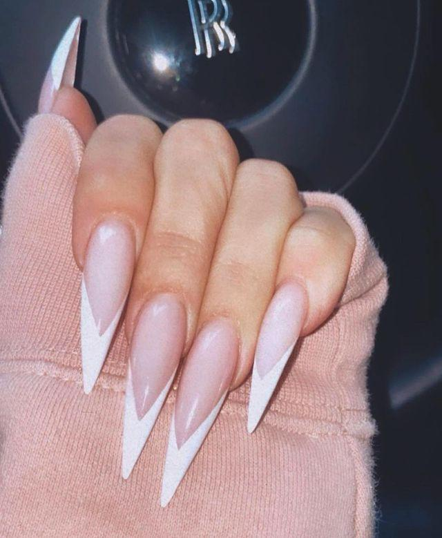 """<p>Is Khloe Kardashian ok? Can someone check? Because ya girl basically just attached tiny knives to each of her fingertips and I'm worried there's going to be bloodshed. Yes, they look fierce. But is the danger really worth it? Is it, Khloe?!</p><p><a href=""""https://www.instagram.com/p/CJrrd5KhxG3/"""" rel=""""nofollow noopener"""" target=""""_blank"""" data-ylk=""""slk:See the original post on Instagram"""" class=""""link rapid-noclick-resp"""">See the original post on Instagram</a></p>"""