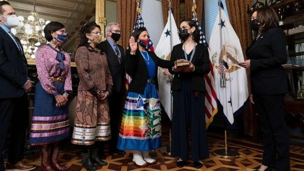 PHOTO: Vice President Kamala Harris, right, speaks during a ceremonial swearing in for Interior Secretary Deb Haaland, third from right, in the Eisenhower Executive Office Building, March 18, 2021, in Washington, D.C. (Alex Brandon/AP)