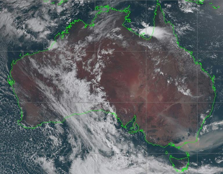 A satellite image on January 3, 2020 shows bushfire smoke (bottom right) drifting off the coast of southeast New South Wales, Australia --  a cloud of smoke from the blazes has been spotted on the other side of the Pacific Ocean