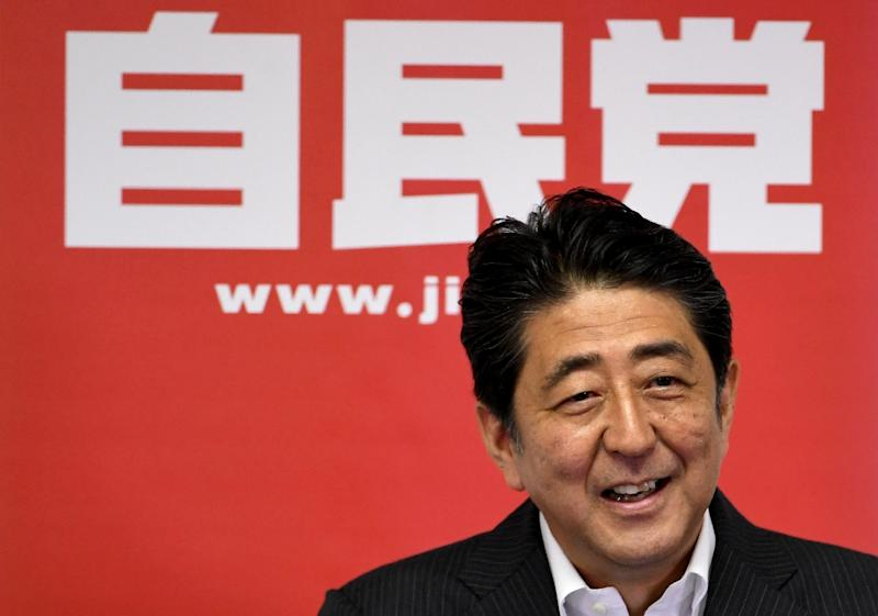 Policymakers are under pressure to boost growth as Prime Minister Shinzo Abe's 'Abenomics' plan to kickstart the world's number three economy (AFP Photo/Toshifumi Kitamura)