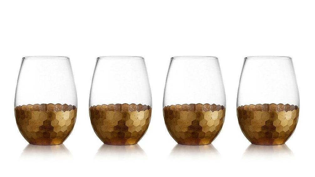 "<p>Wine is worth its weight in gold, so why not get hammered using hammered gold-bottomed glasses? ($32, <a rel=""nofollow"" href=""https://www.amazon.com/Fitz-Floyd-229705-ST-Daphne-Glasses/dp/B00PICR1JS/ref=as_li_ss_tl?ie=UTF8&qid=1490017616&sr=8-1&keywords=gold+wine+glasses&linkCode=ll1&tag=foodandwine2017-20&linkId=2da8a6cb7c828f31cd803eab900b38d7"">Amazon</a>) </p>"