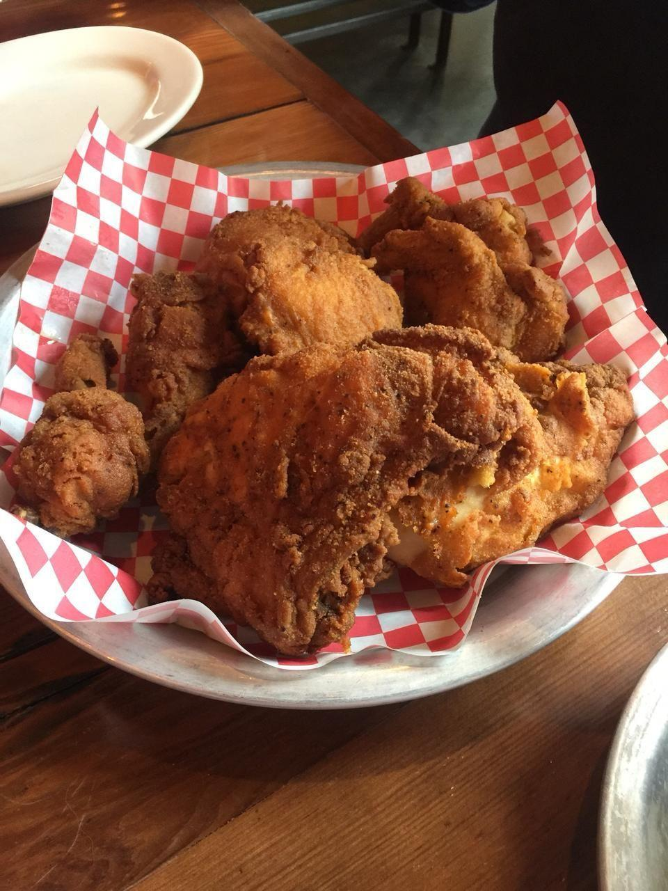 """<p><a href=""""https://www.tripadvisor.com/Restaurant_Review-g37209-d9772148-Reviews-The_Eagle_on_Mass_Ave-Indianapolis_Indiana.html"""" rel=""""nofollow noopener"""" target=""""_blank"""" data-ylk=""""slk:The Eagle"""" class=""""link rapid-noclick-resp"""">The Eagle</a>, Indianapolis</p><p>Be sure to try the <span class=""""entity tip_taste_match"""">honey sauce</span> that comes with the <span class=""""entity tip_taste_match"""">fried chicken</span>. I was hesitant at first, but it adds such a great flavor profile to the <span class=""""entity tip_taste_match"""">chicken</span> resulting in a sweet, savory, heated bite!<span class=""""redactor-invisible-space""""> - Foursquare user <a href=""""https://foursquare.com/inplaywright"""" rel=""""nofollow noopener"""" target=""""_blank"""" data-ylk=""""slk:Tony McDonald"""" class=""""link rapid-noclick-resp"""">Tony McDonald</a></span></p>"""