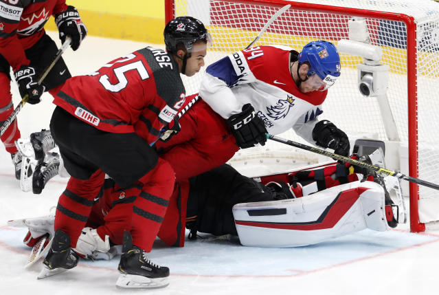 Czech Republic's Radek Faksa falls down on top of Canada's goaltender Matt Murray during the Ice Hockey World Championships semifinal match between Canada and Czech Republic at the Ondrej Nepela Arena in Bratislava, Slovakia, Saturday, May 25, 2019. (AP Photo/Petr David Josek)