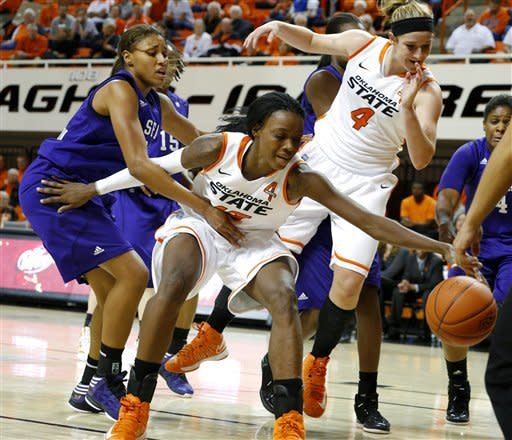 Oklahoma State's Toni Young (15) goes for the ball beside Stephen F. Austin's Tierany Henderson (31) as Oklahoma State's Liz Donohoe (4) watches during their NCAA college basketball game, Thursday, Dec. 6, 2012, in Stillwater, Okla. Oklahoma State won 85-41. (AP Photo/The Oklahoman, Bryan Terry)