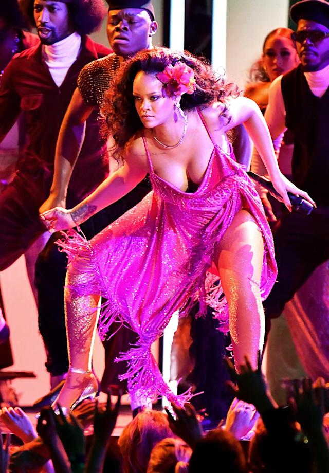 <p>Female artist with the most consecutive weeks on the Hot 100 (216). Also: Only female solo artist to land four No. 1 singles in a calendar year. RiRi achieved the feat in 2010. (Photo by Jeff Kravitz/FilmMagic) </p>