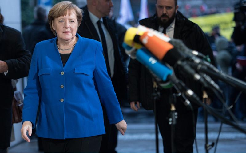 Ms Merkel is attempting to form a coalition to lead in her fourth term in office  - Getty Images Europe