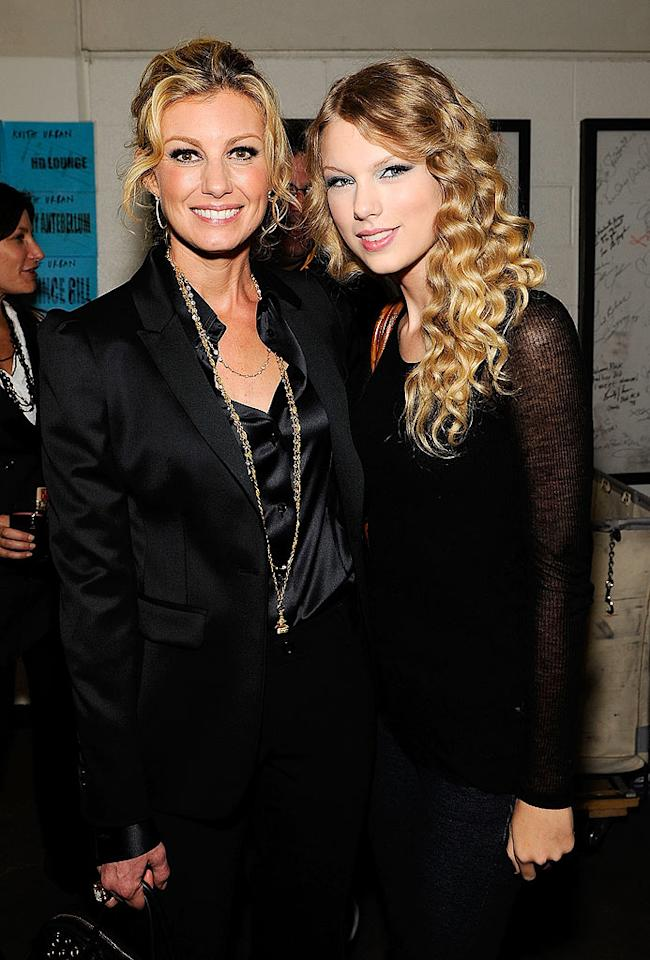 "Faith Hill and Taylor Swift posed backstage at ""We're All for the Hall,"" a special concert benefiting the Country Music Hall of Fame and Museum in Nashville. Larry Busacca/<a href=""http://www.gettyimages.com/"" target=""new"">GettyImages.com</a> - October 13, 2009"