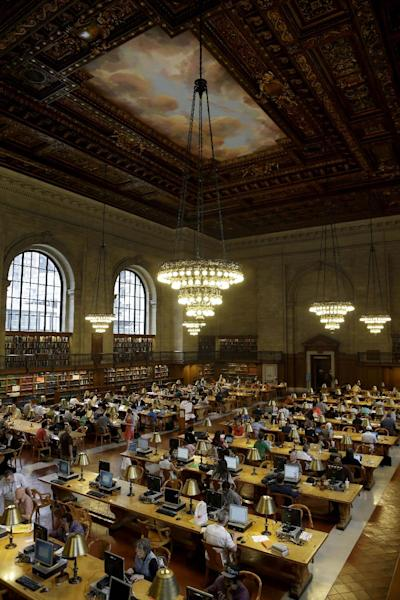 In this Monday, July 22, 2013 photo, patrons use the Rose Reading Room at the main branch of the New York Public Library in New York. Plans for a major change within the New York Public Library's landmark main building have kindled an intellectual culture clash over its direction and the future of libraries themselves. (AP Photo/Seth Wenig)