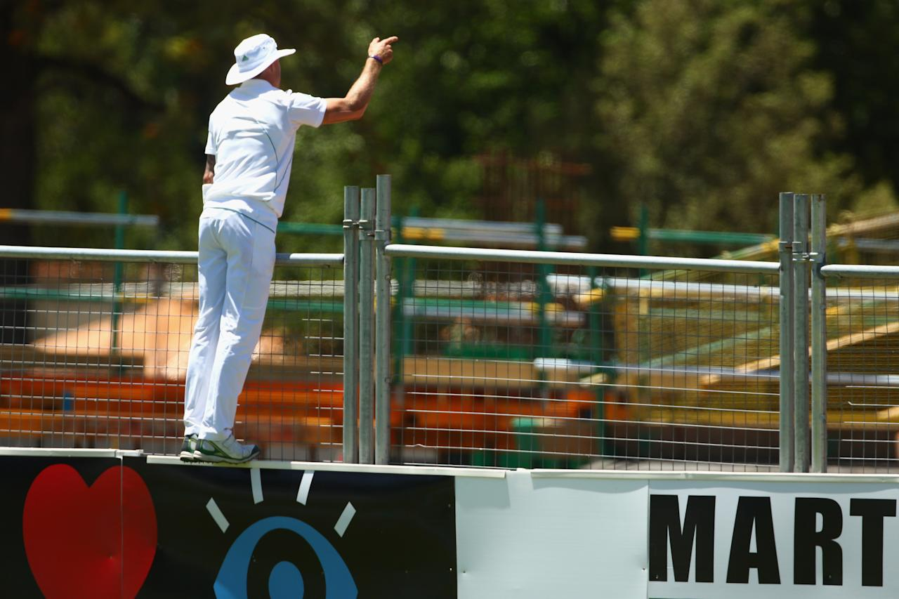 ADELAIDE, AUSTRALIA - NOVEMBER 22:  Dale Steyn of South Africa directs a worker on the new stand building site to collect a ball was hit for six during day one of the 2nd Test match between Australia and South Africa at Adelaide Oval on November 22, 2012 in Adelaide, Australia.  (Photo by Mark Kolbe/Getty Images)