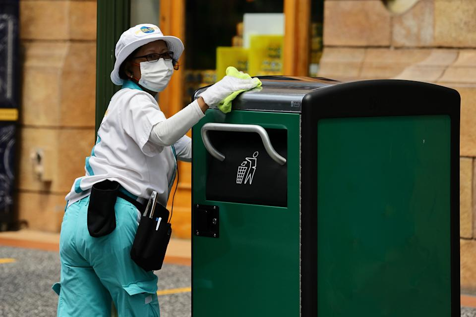 SINGAPORE - JULY 03:  A staff wearing protective mask cleans and disinfects high touch points at Universal Studios at Resorts World Sentosa on July 3, 2020 in Singapore. From July 1, Universal Studios Singapore reopened its door to visitors but operating capacity is limited to no more than 25 per cent as Singapore further eased the coronavirus (COVID-19) restrictions. Universal Studios is among the 13 key attractions to resume its operation in stages with safe management measures in place. As of July 3, the total number of COVID-19 cases in the country stands at 44,479.  (Photo by Suhaimi Abdullah/Getty Images)